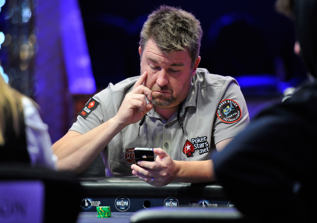Professional poker player Chris Moneymaker checks his phone while he plays during day 2A/2B of the World Series of Poker Main Event at the Rio hotel-casino on Tuesday, July 8, 2014. (David Becker/ ...