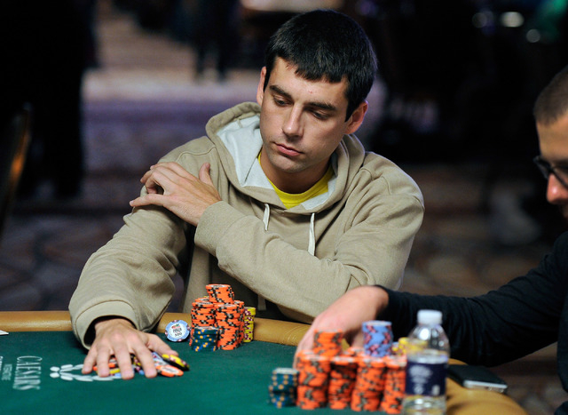 Stephen Graner of Las Vegas, collects his chips during day four of the the World Series of Poker Main Event at the Rio hotel-casino on Friday, July 11, 2014. (David Becker/Las Vegas Review-Journal)
