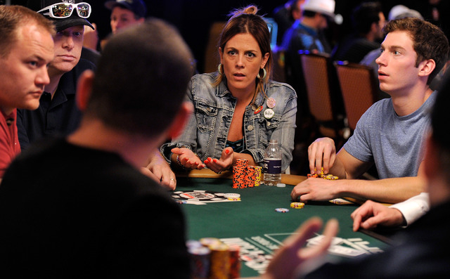 Maria Mayrinck, center, speaks with other players during day four of the the World Series of Poker Main Event at the Rio hotel-casino on Friday, July 11, 2014. (David Becker/Las Vegas Review-Journal)