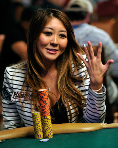 Maria Ho shows off her painted nails during day four of the the World Series of Poker Main Event at the Rio hotel-casino on Friday, July 11, 2014. (David Becker/Las Vegas Review-Journal)