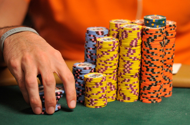 Scott Blackman's pile of chips are stack in front of him during day four of the the World Series of Poker Main Event at the Rio hotel-casino on Friday, July 11, 2014. Blackman started the day in f ...