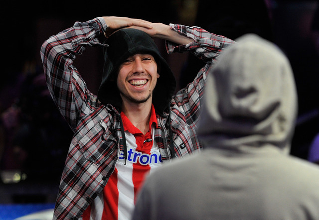 Poker player Andoni Larrabe reacts after winning a hand on an all in bet, knocking out Scott Mahin, during day 7 of the World Series of Poker Main Event at the Rio hotel-casino on Monday, July 14, ...