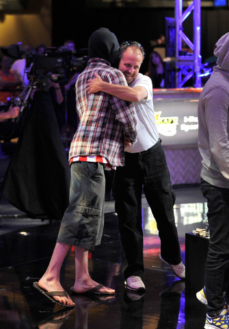Poker players Andoni Larrabe, left, and Scott Mahin, hug after Mahin was eliminated on an all in bet against Larrabe during day 7 of the World Series of Poker Main Event at the Rio hotel-casino on ...