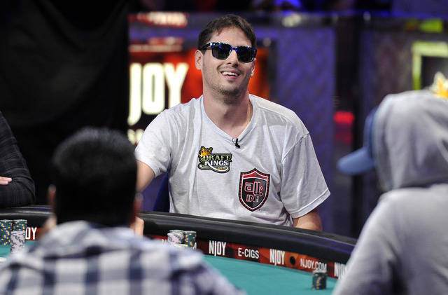 Mark Newhouse smiles after winning a hand during day 7 of the World Series of Poker Main Event at the Rio hotel-casino on Monday, July 14, 2014. (David Becker/Las Vegas Review-Journal)