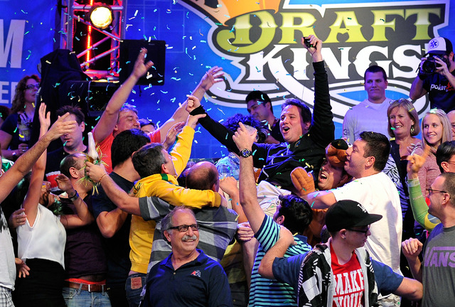 Bruno Politano, center, of Brazil, celebrates with his fan after completing day seven of the World Series of Poker Main Event at the Rio hotel-casino on Tuesday, July 15, 2014. Politano survived t ...