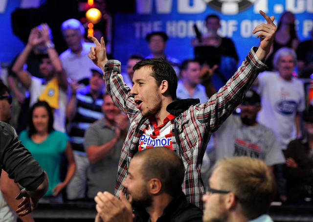 Andoni Larrabe celebrates after surviving to the final table after completing day seven of the World Series of Poker Main Event at the Rio hotel-casino on Tuesday, July 15, 2014. (David Becker/Las ...