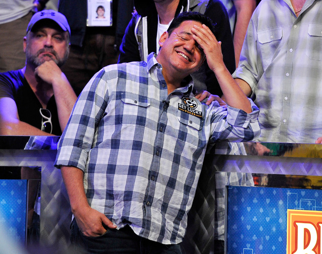 Luis Velador covers head as he stands with fans after loosing with an all in bet during day seven of the World Series of Poker Main Event at the Rio hotel-casino on Tuesday, July 15, 2014. Velador ...