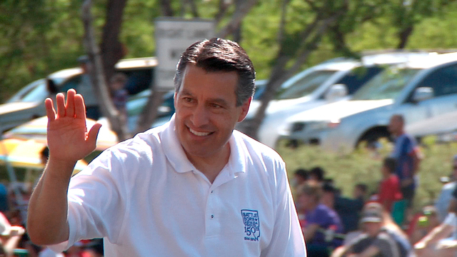 Governor Brian Sandoval waves to the crowd along the route of the Annual Summerlin 4th of July Parade. The governor named the parade an official event of the Nevada's Sesquicentennial Jubilee. (Mi ...