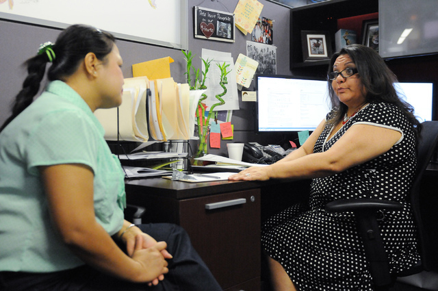 Marie Rasasak, left, is assisted by Doreen Guerra, lead case manager at the One-Stop Career Center. One-Stop Career Center recently celebrated their one-year anniversary since their opening. (Erik ...