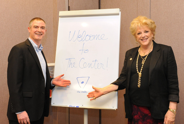 Tom Kovatch, interim CEO for The Center, and Las Vegas Mayor Carolyn Goodman pose next to a sign at the ribbon-cutting event signifying a partnership between City of Las Vegas, The Center and UNLV ...