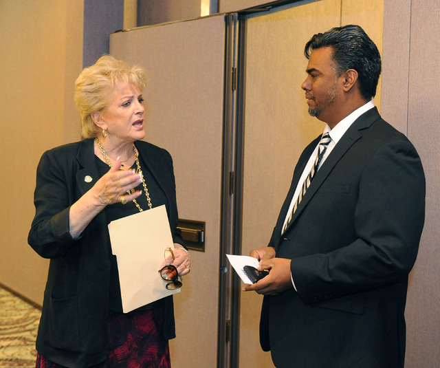 Las Vegas Mayor Carolyn Goodman speaks with Andres Gonzalez, development officer for The Center, at the ribbon-cutting event signifying a partnership between City of Las Vegas, The Center and UNLV ...
