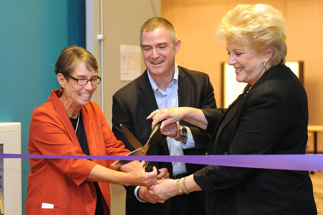 """Margaret """"Peg"""" Rees, left, Tom Kovatch and Las Vegas Mayor Carolyn Goodman snip the ribbon at the ribbon-cutting event signifying a partnership between City of Las Vegas, The Center and UNLV at Th ..."""