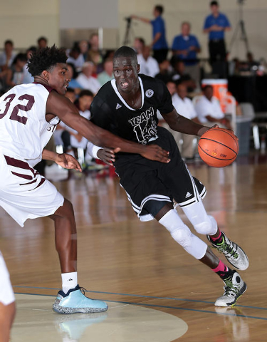 Thon Maker of Team Loaded Virginia drives to the basket during adidas Uprising at the Cashman Center. (Photo by Kelly Kline/adidas)