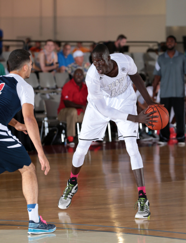 Thon Maker of Team Loaded Virginia looks to make a move on offense during adidas Uprising at the Cashman Center. (Photo by Kelly Kline/adidas)
