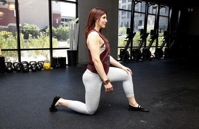 Trainer Laura Salcedo demonstrates the starting position for the kneeling hip flexor stretch at CrossFit Mountain's edge in Las Vegas on Tuesday, June 24, 2014. (Justin Yurkanin/Las Vegas Review-J ...