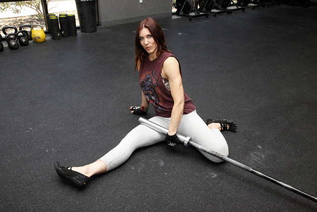 Trainer Laura Salcedo demonstrates the finishing position for the abductor stretch at CrossFit Mountain's edge in Las Vegas on Tuesday, June 24, 2014. (Justin Yurkanin/Las Vegas Review-Journal).