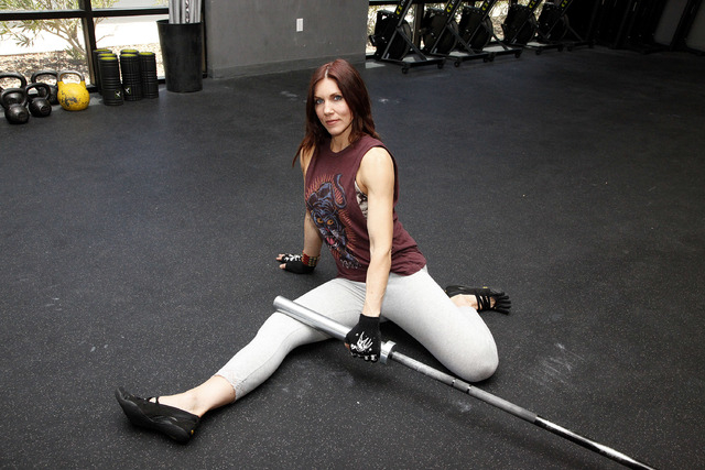 Trainer Laura Salcedo demonstrates the starting position for the abductor stretch at CrossFit Mountain's edge in Las Vegas on Tuesday, June 24, 2014. (Justin Yurkanin/Las Vegas Review-Journal).