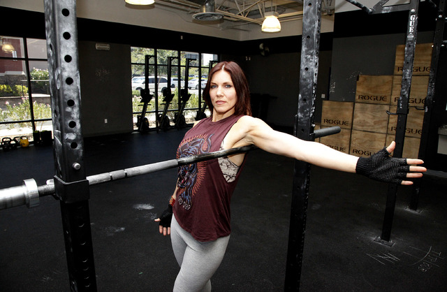 Trainer Laura Salcedo demonstrates the finishing position for the lat stretch at CrossFit Mountain's edge in Las Vegas on Tuesday, June 24, 2014. (Justin Yurkanin/Las Vegas Review-Journal).
