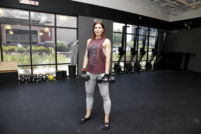 Trainer Laura Salcedo demonstrates the starting position for the dumbbell deadlift at CrossFit Mountain's edge in Las Vegas on Tuesday, June 24, 2014. (Justin Yurkanin/Las Vegas Review-Journal).