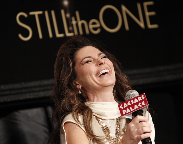 Shania Twain laughs while answering a question during a press conference for her show Shania: Still the One at Caesars Palace in Las Vegas Friday, Nov. 30, 2012. (John Locher/Las Vegas Review-Journal)