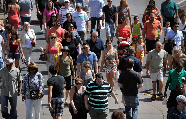 Tourists walk along the Strip on Tuesday, June 17, 2014. (David Becker/Las Vegas Review-Journal)
