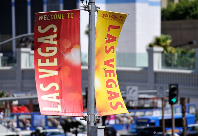 Banners welcome tourists along the Strip on Tuesday, June 17, 2014.  (David Becker/Las Vegas Review-Journal)