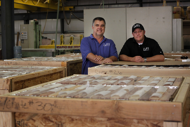 Las Vegas Rock Inc. owner Steve Wickman, left, and Vice President Justin Lindblad pose for a portrait amongst product set for shipment at their stone fabrication and cutting facility in Jean on Tu ...