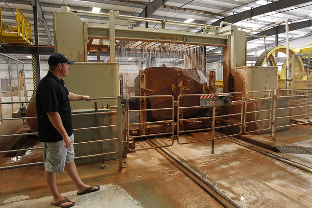 Las Vegas Rock Inc. Vice President Justin Lindblad watches a stone being cut by a gang saw at their stone fabrication and cutting facility in Jean on Tuesday, July 29, 2014. The company landed a $ ...