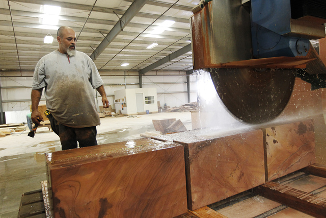 Las Vegas Rock Inc. employee Cesar Gamboa watches as  a bridge saw puts some finishing touches on product meant for Kuwait at the stone fabrication and cutting facility in Jean on Tuesday, July 29 ...