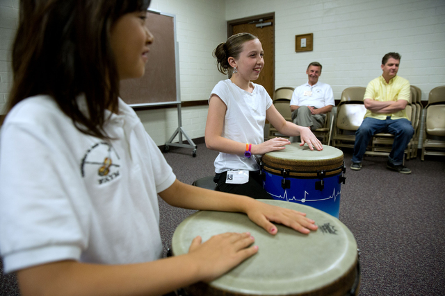 Belle Pobsuk, left, and Aurora Tibbitts play drums during the Foundation to Assist Young Musicians summer camp, June 20. (Samantha Clemens-Kerbs/View)