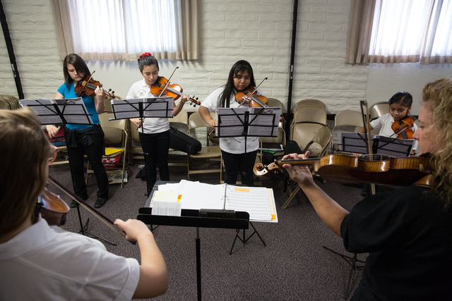 Students practice the violin during the Foundation to Assist Young Musicians summer camp, June 20. (Samantha Clemens-Kerbs/View)