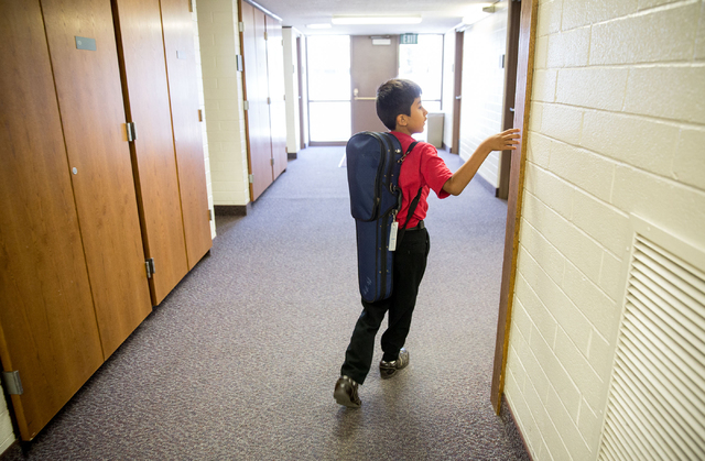 German Ardon walks to a class during the Foundation to Assist Young Musicians summer camp, June 20. (Samantha Clemens-Kerbs/View)