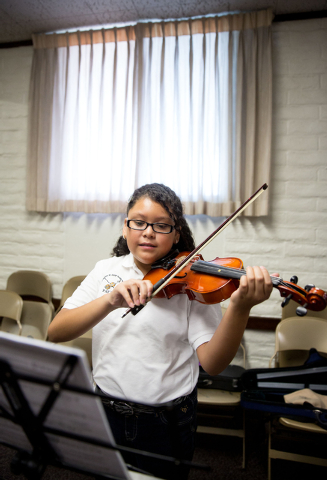 Abigail Garcias practices the violin during the Foundation to Assist Young Musicians summer camp, June 20. (Samantha Clemens-Kerbs/View)