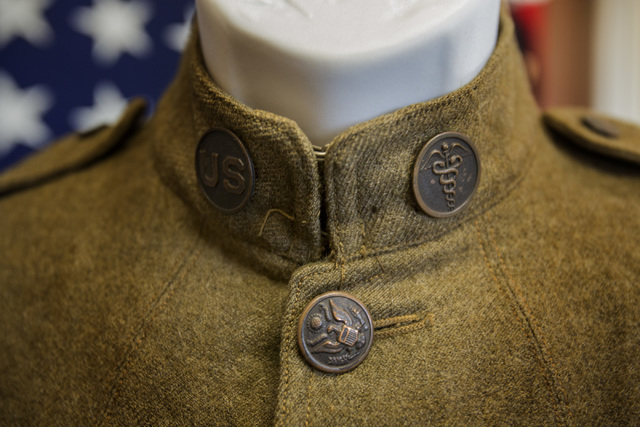 Army Medical Department brass is pinned to the collar of this tunic from Pfc. Thomas E. Heckel's World War I uniform as shown Friday, June 27, 2014 at American Legion Post 8. The post is displayin ...