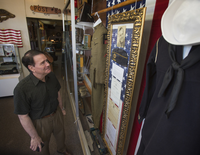 Albert Clark Jr. views a collection of World War I memorabilia of his father Albert Clark Sr., that he loaned to American Legion Post 8,  during the unveiling on Friday, June 27, 2014. (Jeff Schei ...