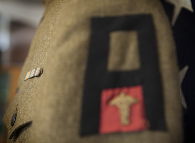 The shoulder patch on Pfc. Thomas E. Heckel's World War I uniform indicates he was in the First Army's Medical Department. The uniform is shown Friday, June 27, 2014 at the American Legion Post 8, ...