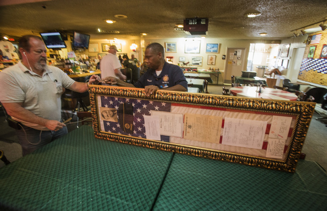 American Legion Sons of American Legion Squadron 8 Commander Michael Vines, left, and Post 8 Adjutant Richard Gray prepare a collection of World War I memorabilia from Albert Clark Sr., on Friday, ...