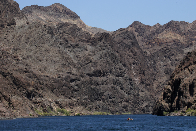 A kayaker explores the Black Canyon Water Trail on the Lower Colorado River in Lake Mead National Recreation Area on the Nevada and Arizona border east of Las Vegas on Thursday, July 3, 2014. Ther ...