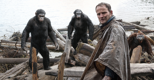 "Malcolm (Jason Clarke) tries to make peace with Caesar (Andy Serkis), Koba (Toby Kebbell) and Maurice (Karin Konoval) in ""Dawn of the Planet of the Apes."" (Courtesy/WETA and Twentieth Century Fox  ..."