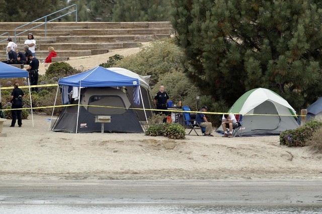 Crime scene tape surrounds tents and campers at the Boy Scout Summer Camp on Fiesta Island Monday, June 30, 2014, after a boy died from a self-inflicted gunshot wound. The 12-year-old boy died fro ...