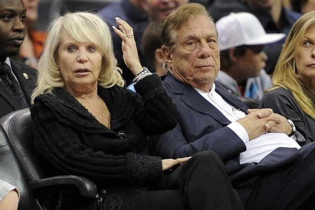 In this Nov. 12, 2010, file photo, Shelly Sterling sits with her husband, Donald Sterling, right, during the Los Angeles Clippers' NBA basketball game against the Detroit Pistons in Los Angeles. W ...