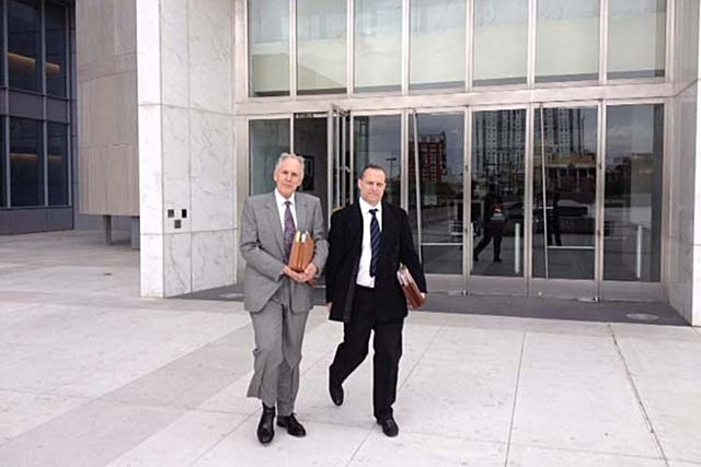 Mitchell Garshofsky, right, leaves the federal courthouse with his attorney, Richard Wright, after pleading guilty in April to running an illegal bookmaking operation. (Jeff German/Las Vegas Revie ...
