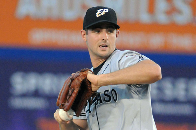 Former Bishop Gorman and College of Southern Nevada ace Donn Roach pitches for the El Paso Chihuahuas against the Las Vegas 51s at Cashman Field, Thursday, July 30, 2014. (Jerry Henkel/Las Vegas R ...