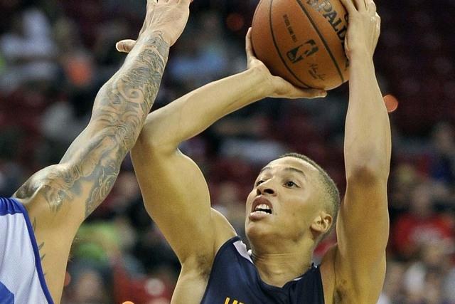 Utah Jazz's Dante Exum (11) shoots against the Philadelphia 76ers during an NBA summer league basketball game on Saturday, July 12, 2014, in Las Vegas. The 76ers won 74-70. (AP Photo/David Becker)
