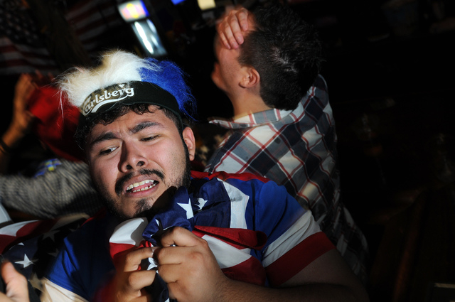 Jose Perez reacts to a goal by Belgium against the United States during a viewing party of the 2014 FIFA World Cup quarter-final soccer game at Crown & Anchor British Pub in Las Vegas Tuesday, Jul ...