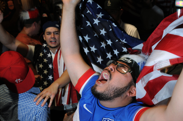 Jose Perez cheers for the United States against Belgium in the 2014 FIFA World Cup quarter-final soccer game during a viewing party at Crown & Anchor British Pub in Las Vegas Tuesday, July 1, 2014 ...