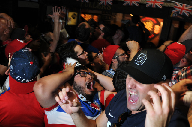 Jose Perez, center, and Brad Franklin, right, react to a play during the 2014 FIFA World Cup quarter-final soccer game between the United States and Belgium at Crown & Anchor British Pub in Las Ve ...