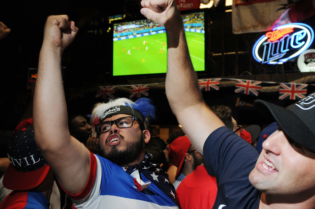 Jose Perez, left, and Brad Franklin, cheer for their team during the 2014 FIFA World Cup quarter-final soccer game between the United States and Belgium at Crown & Anchor British Pub in Las Vegas  ...