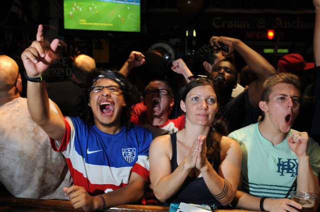 Ismael Gonzales, from left,  Kelly Seibert and Kostner Bailey, react to a play during the 2014 FIFA World Cup quarter-final soccer game between the United States and Belgium at Crown & Anchor Brit ...