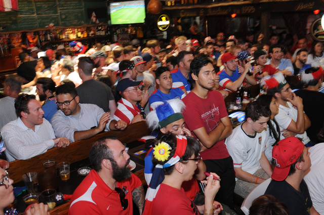 People watch the 2014 FIFA World Cup quarter-final soccer game between the United States and Belgium at a viewing party at Crown & Anchor British Pub in Las Vegas Tuesday, July 1, 2014. (Erik Verd ...